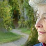 Close up of side profile of woman at retirement age to represent estate planning services
