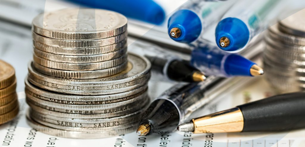 Close up of coins and pens to represent GST Management