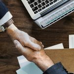 Close up of handshake to represent selling a business
