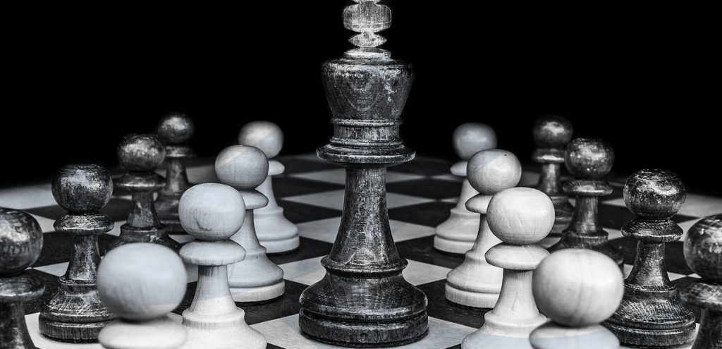 Black and white close up of chess pieces to represent Succession Planning