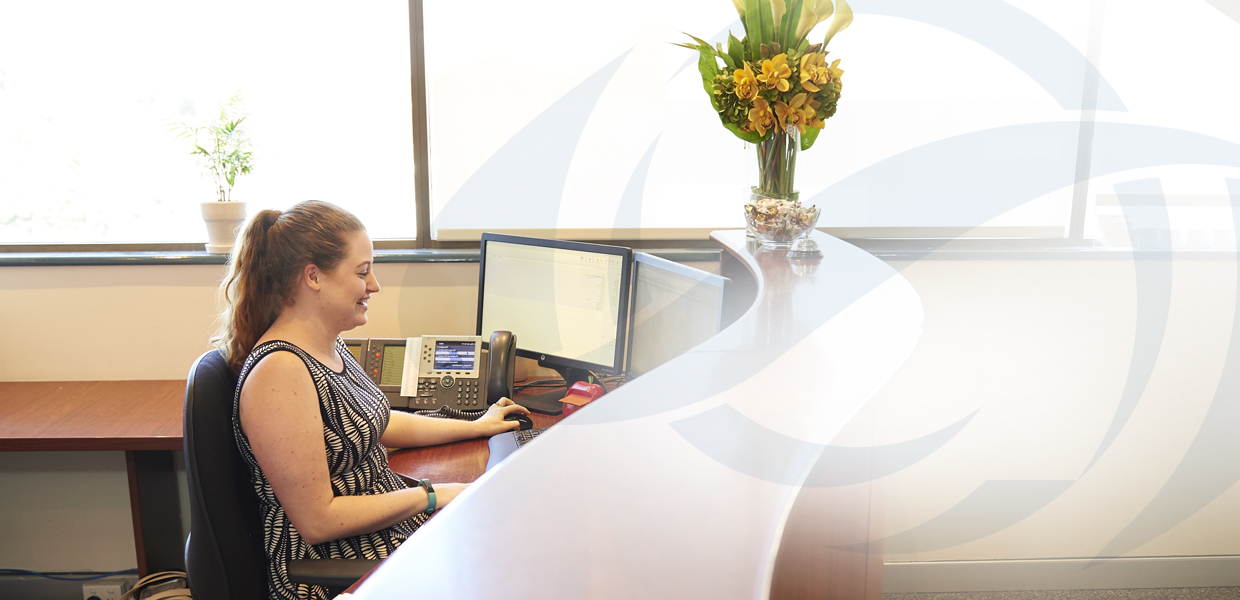 Receptionist at Paragon Consultants at desk in Nedlands Office